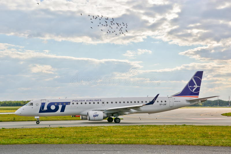Plane SP-LNF. This is a view of LOT - Polish Airlines plane Embraer ERJ 170 registered as SP-LNF on the Warsaw Chopin Airport. July 30, 2015. Warsaw, Poland royalty free stock photos