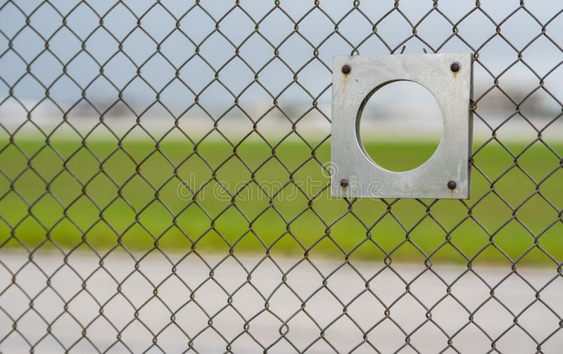 Plane spotter airport fence viewing hole stock photography