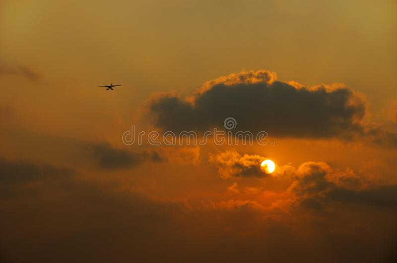 Plane with sunrise background stock photo