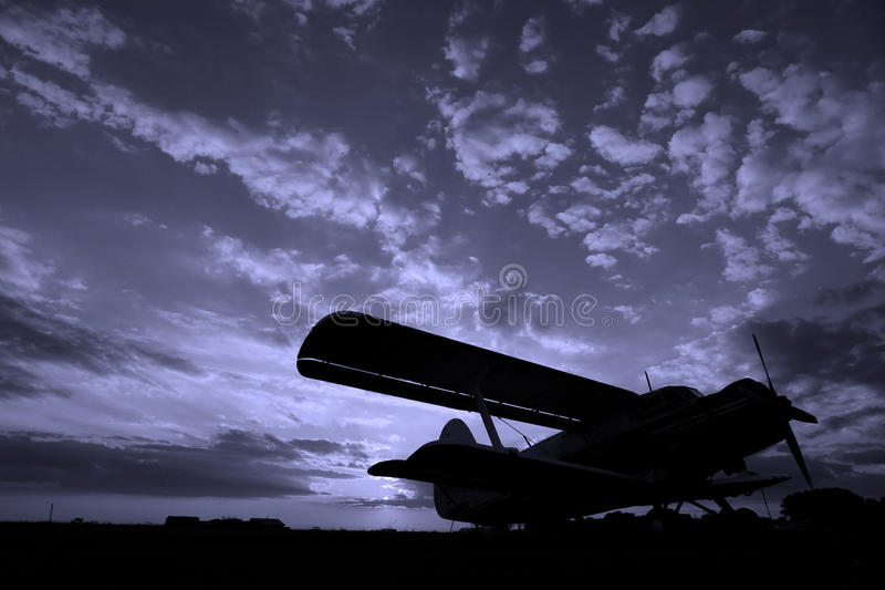 Plane at sunset royalty free stock images