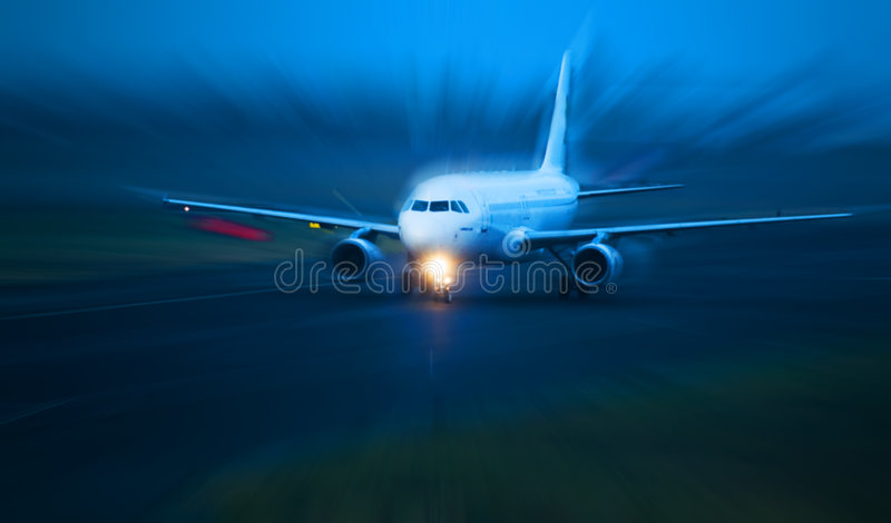 Plane takes of at dusk. Motion blured concept stock images