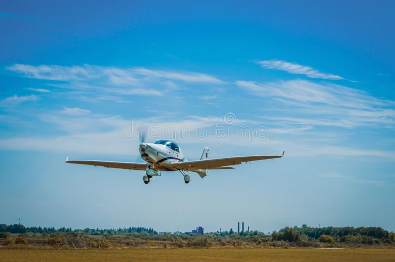The plane takes off from the grass stock photo