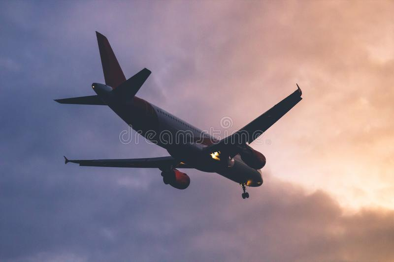 The plane takes off from twilight in the direction of the rising sun.  stock photography