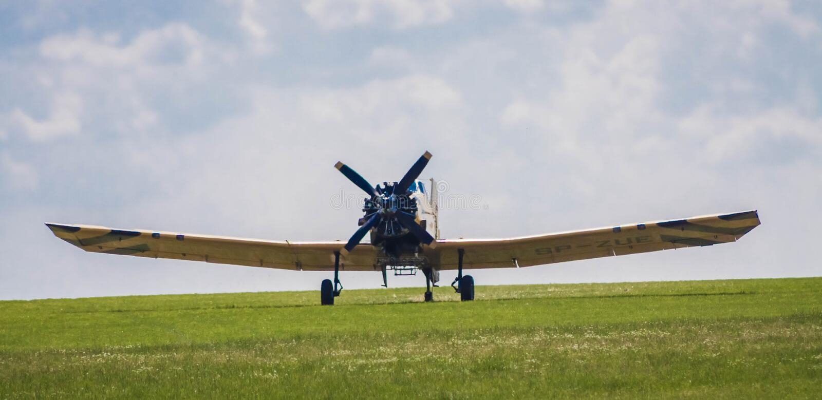 Plane taking off from the grass. Plane on an air show taking off from the grass. Panoramic view. It has got 1500 horsepower royalty free stock photos