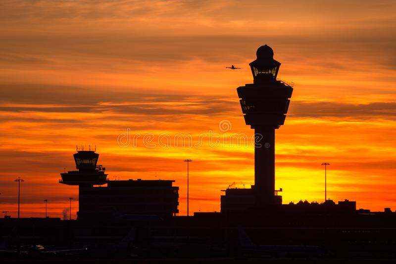 Amsterdam Schiphol airport sunset. Plane taking off from Schiphol international airport at sunset. Amsterdam, The Netherlands stock photo