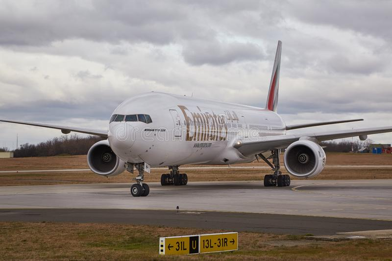 Plane taxiing at airport. BUDAPEST, HUNGARY - DECEMBER 1, 2016: Airliner of Emirates taxiing at Budapest Liszt Ferenc Airport. Being 777-300 royalty free stock photo