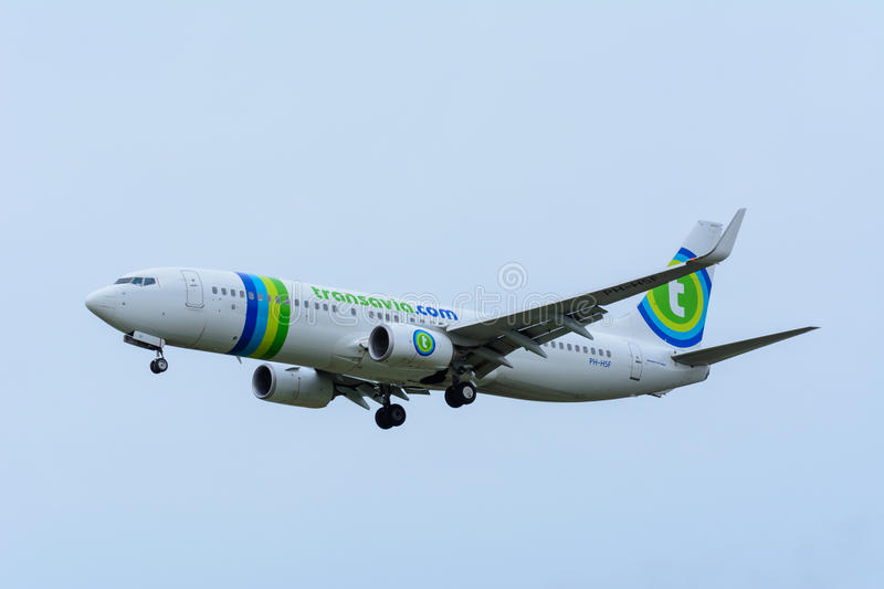 Plane from Transavia PH-HSF Boeing 737-800 is landing at Schiphol Airport. royalty free stock photography