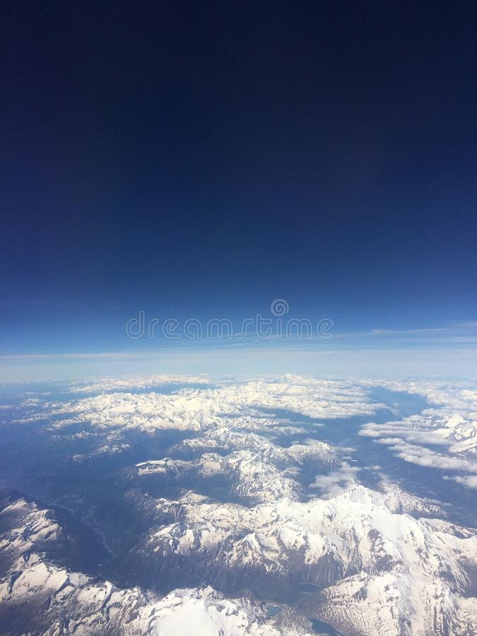 Plane view over the alps royalty free stock photo