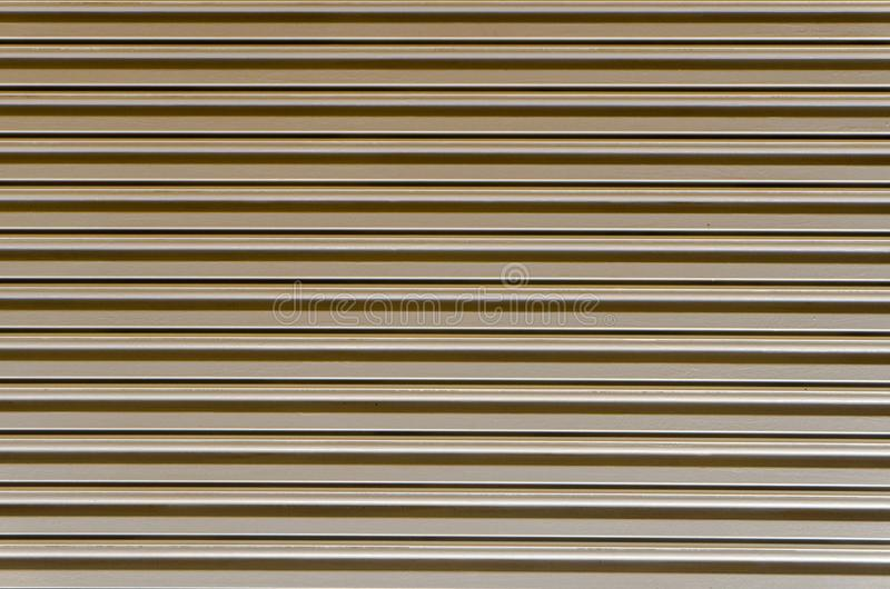 Plane view of straight line pattern of warehouse`s ripple shutter roller door.  stock images