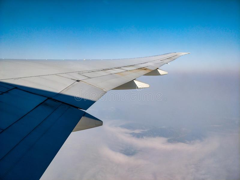 Plane wing above the clouds view cloudy sky. Witch copy space stock image