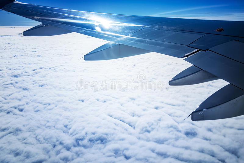Plane wing and clouds royalty free stock photo