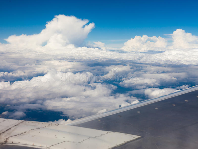 Plane wing, ground, clouds and sky royalty free stock photography