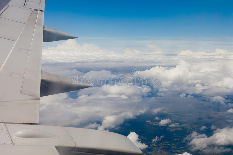 Plane wing, ground, clouds and sky stock photography