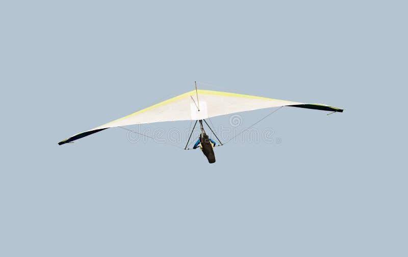 Planeador de caída amarillo y blanco en vuelo apagado, aislado en azul claro foto de archivo libre de regalías
