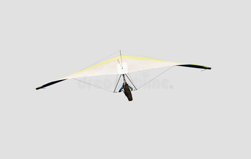 Planeador de caída amarillo y blanco en vuelo apagado, aislado en gris claro fotografía de archivo libre de regalías
