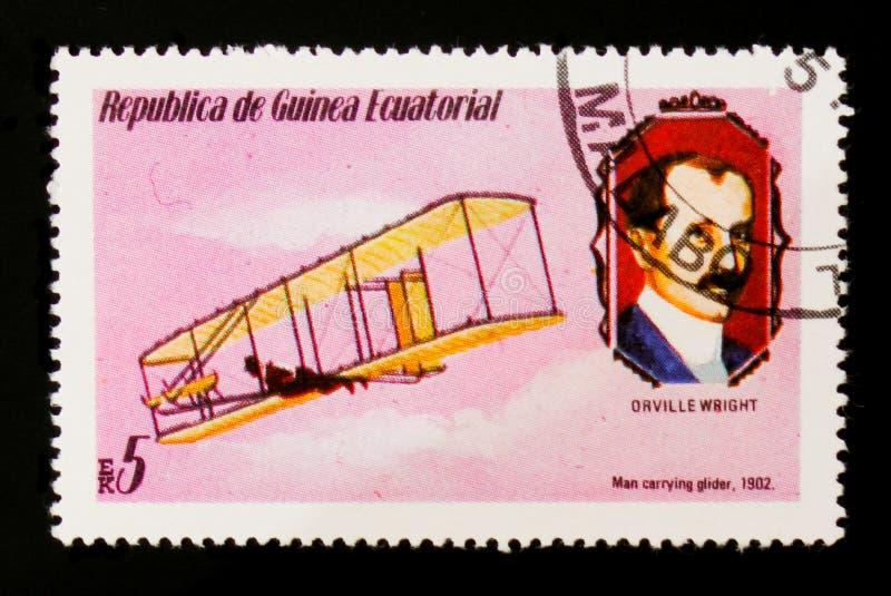 Planeador que lleva 1902 y O del hombre Retrato de Wright, circa 1979 imagen de archivo