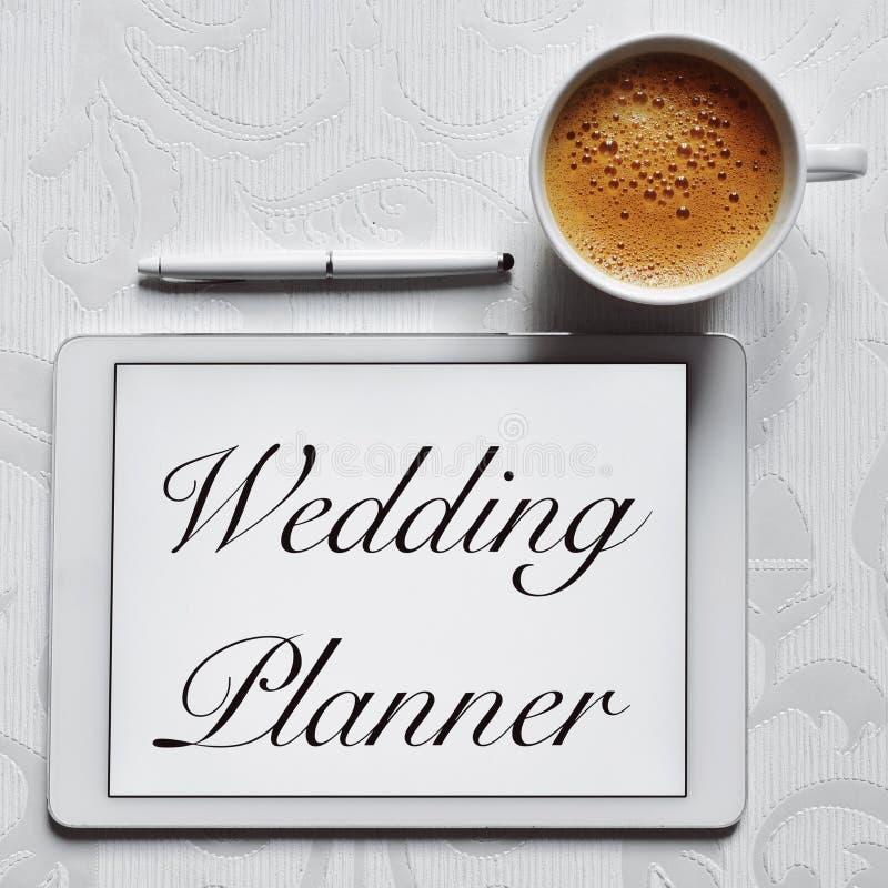 Planejador do casamento do texto em um tablet pc foto de stock royalty free