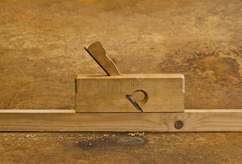 Download Planer On Wood In Rusty Background Stock Image - Image: 21856791