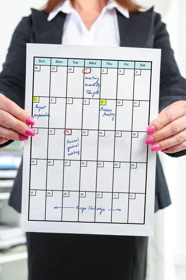 Planerkonzept gezeigt von einer Geschäftsfrau stockfoto