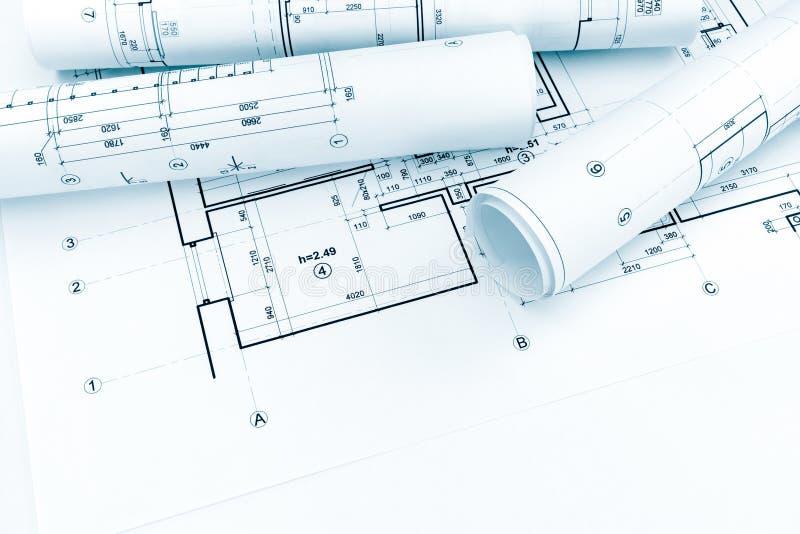 Planes arquitectónicos rodados y dibujos técnicos en bluep de la casa foto de archivo libre de regalías