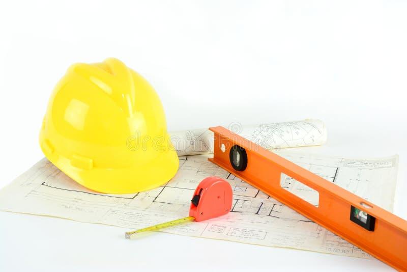 Planes, casco de protección y herramientas de la casa foto de archivo