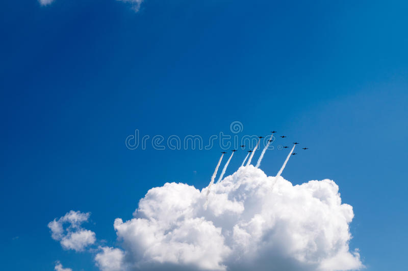 12 Planes Flying Out of a Cloud royalty free stock photos