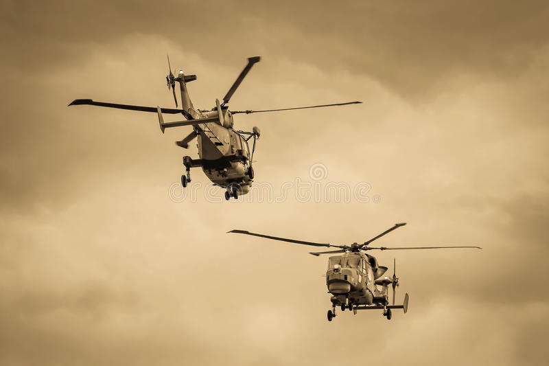 Planes jets and helicopters flying during airshow stock image