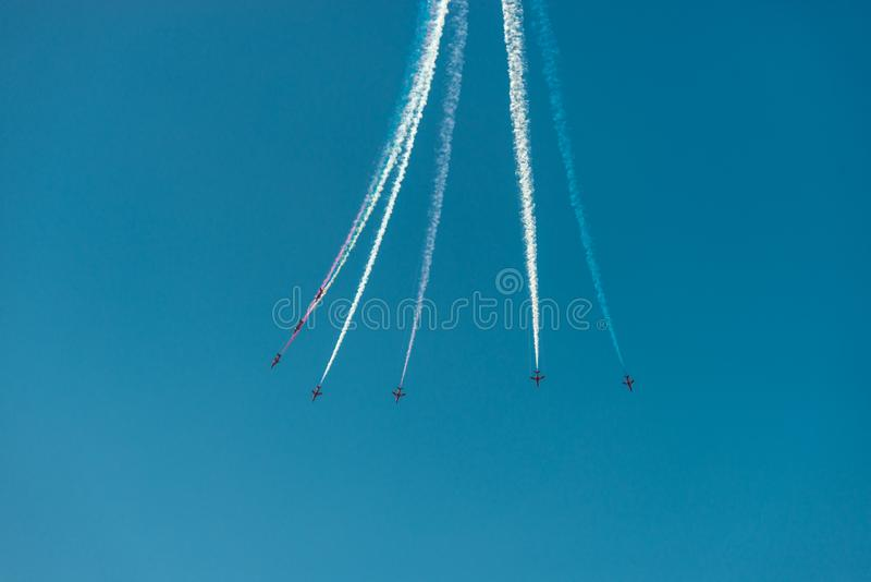 Planes with multicolor trails during Bournemouth Airshow stock image