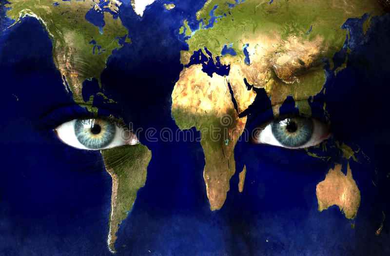 Planet earth and blue eyes royalty free stock images