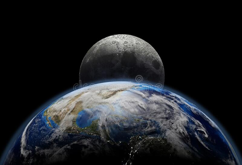 Planet earth close up with sunrise in space, city lights and moon royalty free stock image
