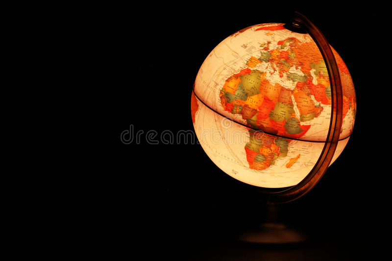 Planet Earth glowing globe. Earth over Africa and Europe represented by glowing desk globe in black sky royalty free stock image