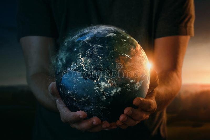 Planet earth in human hands stock photo