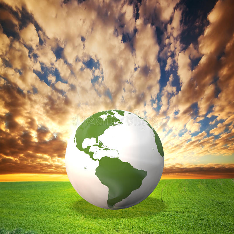 Planet Earth model on green field royalty free stock photography