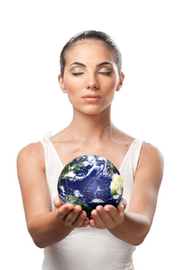 Planet earth protection. Peaceful beautiful woman holding planet earth with care and responsibility, symbol of environment protection royalty free stock image