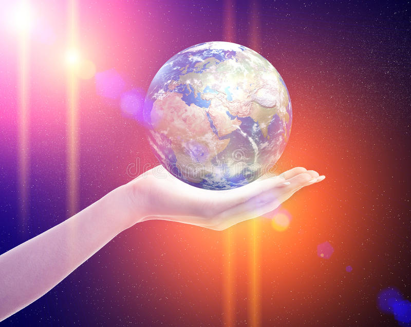 Planet earth in woman's hand stock photos