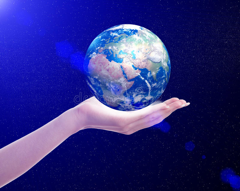 Planet earth in woman's hand royalty free stock image