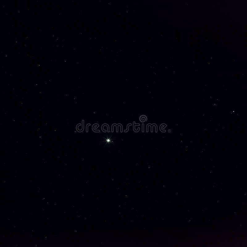 Planet Jupiter with bright satellites in starry sky at night royalty free stock images