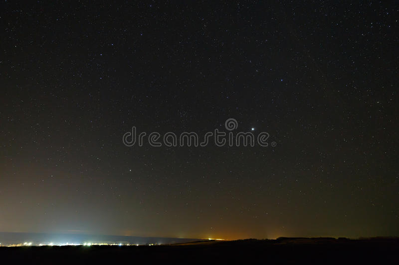 Planet Jupiter in the night starry sky royalty free stock photos