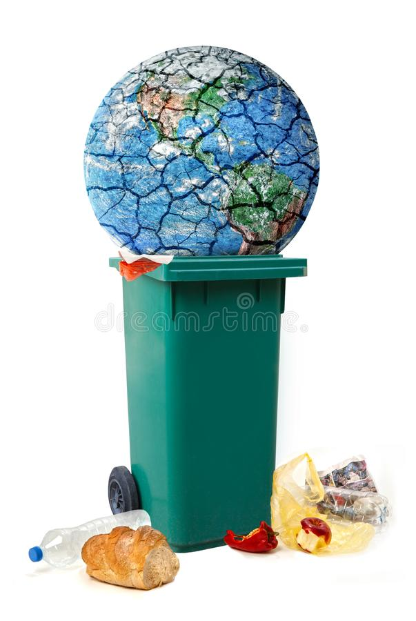 Planeten som förstör den begreppsmässiga bilden, planetjord, är trown in i avskräde, deiscarded mat, avfalls arkivbild