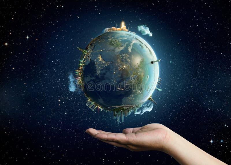 Planetenerde auf Palme lizenzfreie stockbilder