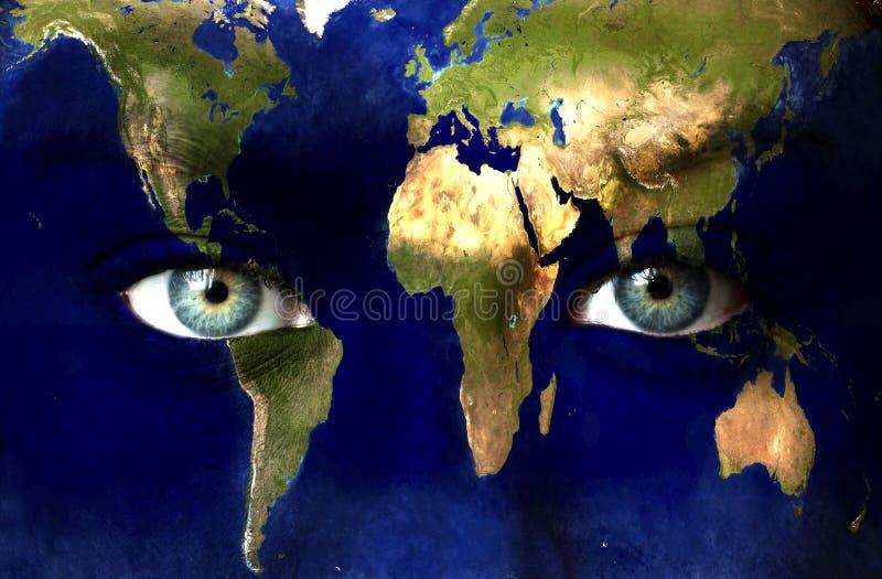 Planetjord och blåa mänskliga ögon arkivbilder