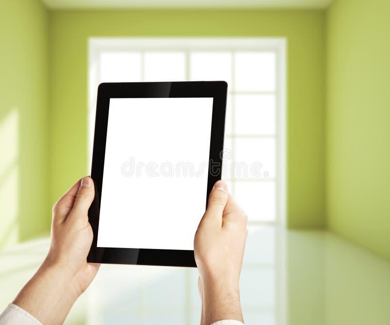 Planhus på tableten fotografering för bildbyråer
