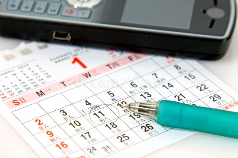 Planificación con el calendario imágenes de archivo libres de regalías
