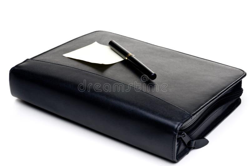 Planificador del día con una nota en blanco imagenes de archivo