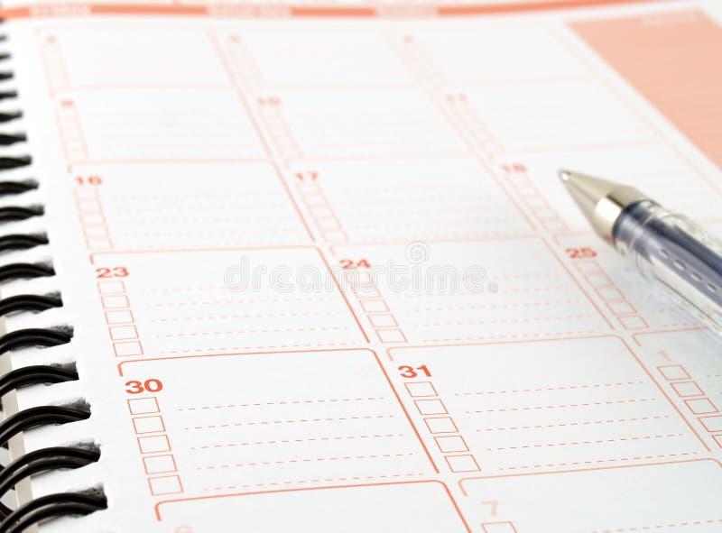 Planificador del diario, diario del cuaderno con la pluma imágenes de archivo libres de regalías