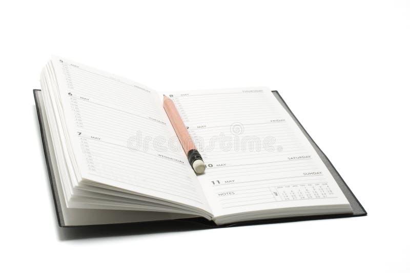 Planificador del lápiz y del bolsillo fotografía de archivo