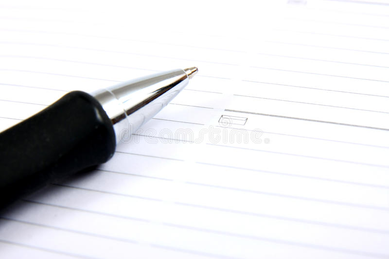 Planificador y pluma del bolsillo del asunto foto de archivo libre de regalías
