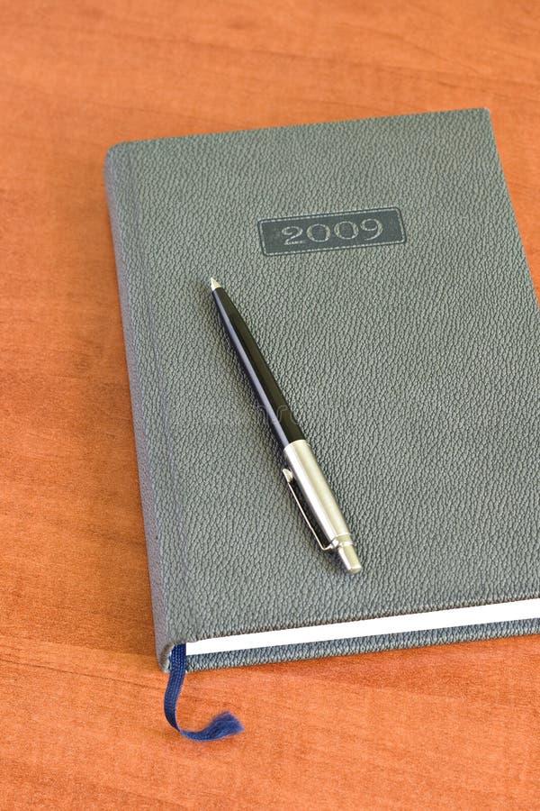 Planificateur et crayon lecteur de poche images stock