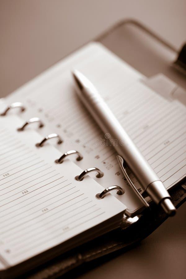 Planificateur et crayon lecteur de poche photos stock