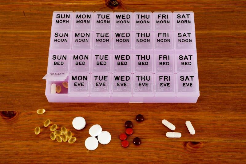 Planificateur mensuel de pilules image libre de droits